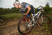 Theo Blignaut of team RECM mixed attends to a damaged tyre during stage 1 of the 2014 Absa Cape Epic Mountain Bike stage race held from Arabella Wines in Robertson, South Africa on the 24 March 2014<br /> <br /> Photo by Greg Beadle/Cape Epic/SPORTZPICS