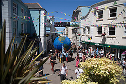 © Licensed to London News Pictures.  12/06/2021. Falmouth, UK. An XR protest passes along streets of Falmouth, Cornwall on the second day of the G7. Photo credit: Marcin Nowak/LNP