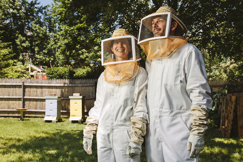 Jen and Michael Gazdacko and their beehives at Barking Dog Farm. Photographed on June 15, 2014 in Providence, RI. (Photo by Cat Laine)