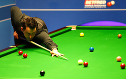 Ronnie O'Sullivan in action against against Ding Junhui, on day twelve of the Betfred Snooker World Championships at the Crucible Theatre, Sheffield. PRESS ASSOCIATION Photo. Picture date: Wednesday April 26, 2017. See PA story SNOOKER World. Photo credit should read: Martin Rickett/PA Wire