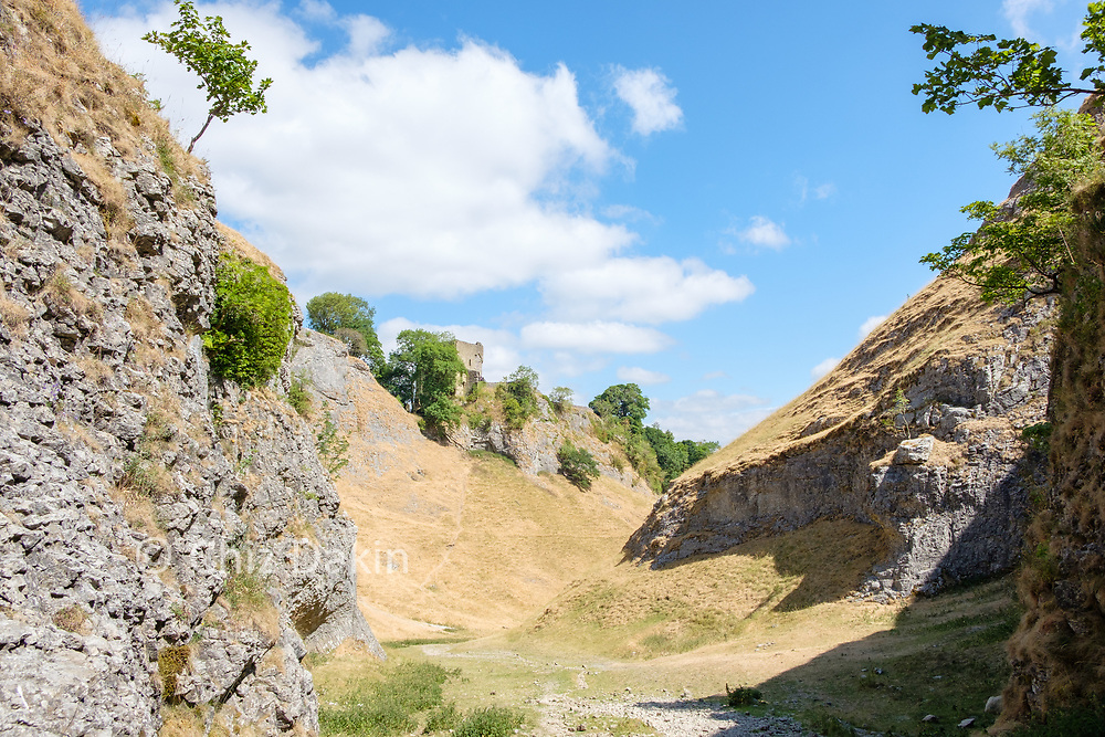 Looking down Cave Dale with Peveril Castle standing proud on the skyline above