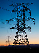 Dusk descending over the high tension electric line distributing power from the Bonanza coal-fired power plant, Uintah Basin, Utah.