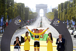 July 29, 2018 - Paris, France - British rider GERAINT THOMAS of Team Sky wearing the yellow jersey of overall leader celebrates on the podium after winning the 105th edition of the Tour de France cycling race, 116km from Houilles to Paris, France. (Credit Image: © Panoramic via ZUMA Press)