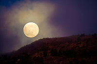 Full moon over the Teide Volcano, Teide National Park,  Tenerife Island, Canary Islands, Spain.