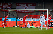 GOAL 3-0 Crawley Town defender Jordan Tunnicliffe (19) not shown scores as Crawley Town celebrate and Leeds United midfielder Kalvin Phillips (23) looks on during the The FA Cup match between Crawley Town and Leeds United at The People's Pension Stadium, Crawley, England on 10 January 2021.