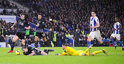 Brighton & Hove Albion goalkeeper Mathew Ryan (left) fouls Burnley's Ashley Barnes collide resulting in a penalty during the Premier League match at the AMEX Stadium, Brighton.