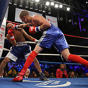 """Anthony Mercado (right) fights Javier Perez during a """"Boxeo Telemundo""""  boxing match at the Kissimmee Civic Center on Friday, July 18, 2014 in Kissimmee, Florida.  (AP Photo/Alex Menendez)"""