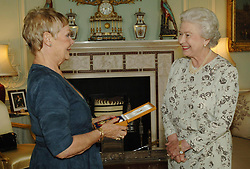 RETRANSMISSION with correct spelling of DENCH Queen Elizabeth II invests Dame Judi Dench with the Insignia of a Companion of Honour at Buckingham Palace, Wednesday October 26, 2005. POOL PRESS ASSOCIATION photograph. Fiona Hanson/Pool/PA