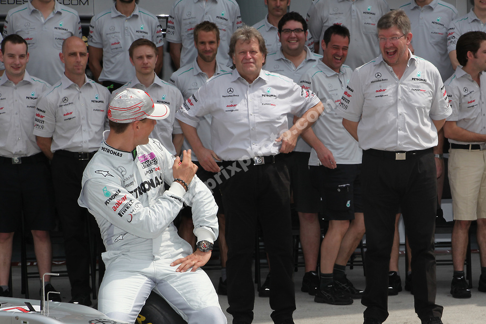 Michael Schumacher and Mercedes team principal Ross Brawn share a joke before the 2011 Malaysian Grand Prix in Sepang outside Kuala Lumpur. Also in the picture: Norbert Haug. Photo: Grand Prix Photo