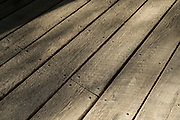 Timber planks of wooden floor of The Old Covered Bridge, also known as Upper Sheffield Covered bridge by Sheffield Plain, Massachusetts
