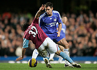 Photo: Marc Atkins.<br />Chelsea v West Ham United. The Barclays Premiership. 18/11/2006. Carlos Tevez of West Ham & Frank Lampard of Chelsea in action.
