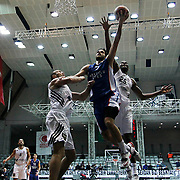 Besiktas integral Forex's Jajuan Johnson (R) and Anadolu Efes's Stratos Perperoglou (C) during their Turkish basketball league match Besiktas integral Forex between Anadolu Efes at BJK Akatlar Arena in Istanbul, Turkey, Monday, January 05, 2015. Photo by TURKPIX