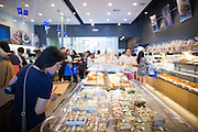 Guests shop for pastries, coffee, and shaved ice during the Grand Opening Ribbon Cutting Ceremony at Paris Baguette Cafe in Milpitas, California, on May 16, 2014. (Stan Olszewski/SOSKIphoto)
