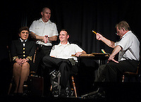 "Doreen Sheppard (Lieutenant Commander JoAnne Galloway), Scott Alward (Lieutenant Sam Weinberg), Chris Fernandez (Lieutenant Daniel Kaffee) and Eric Marsh (Captain Whitaker) during Laconia Streetcar Company dress rehearsal for ""A Few Good Men"" Thursday evening at Laconia High School.  (Karen Bobotas/for the Laconia Daily Sun)"