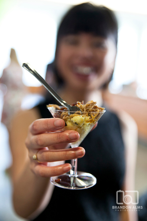 Woman holds out an appetizer at a 417 Magazine Event.