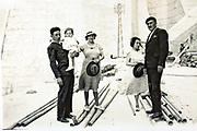 family posing on a large industrial construction site 1930s