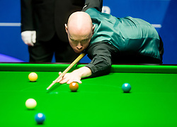 Gary Wilson in action against Ronnie O'Sullivan on day two of the Betfred Snooker World Championships at the Crucible Theatre, Sheffield.