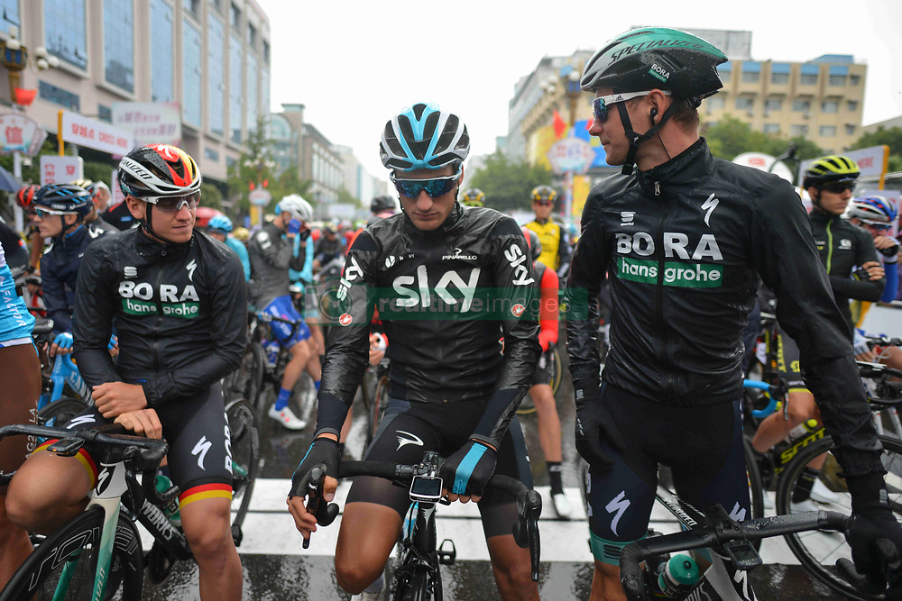 October 21, 2018 - Guilin, China - (Left - Right) Pascal Ackermann of Germany and Bora - Hansgrohe Team, Gianni Moscon of Italy and Team SKY, and Felix Grosschartner of Germany and Bora - Hansgrohe Team, chat together at the start line ahead of the six and final stage, 169km Guilin Stage, of the 2nd Cycling Tour de Guangxi 2018. .On Sunday, October 21, 2018, in, Guilin, China. (Credit Image: © Artur Widak/NurPhoto via ZUMA Press)
