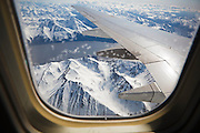 View of Turnagain Arm, dividing the Kenai and Chugach Mountains, through the window of an airplane landing in Anchorage, Alaska.