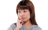 Young oriental woman very pensive and worried.