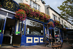 © Licensed to London News Pictures. 16/10/2020. London, UK. An exterior view of JD Weatherspoon's pub, 'The Toll Gate', in north London. The pub chain announced a £95m annual pre-tax loss, its first since 1984 due to the coronavirus lockdown restrictions on the pub industry. Yesterday, the government announced that from midnight tonight, households in London will not be allowed to mix indoors, including in pubs and restaurants, as London moves into Tier 2 COVID-19 restrictions. Photo credit: Dinendra Haria/LNP