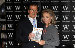 File photo dated 15/10/08 of Sir Roger Moore with his wife, Kristina, as he signs copies of his autobiography 'My Word Is My Bond' at Waterstone's Piccadilly in London. Sir Roger has died in Switzerland after a short battle with cancer, his family has announced.