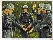 German re-armament and militarisation: German army recruits taking their oath of loyalty on the flag.  From series of 270 cigarette cards 'Die Deutsche Wehrmacht', Dresden, 1936.