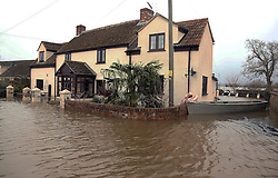 © Licensed to London News Pictures. 17/02/2014. DUNBALL, UK A flooded house in Moorland today 17th February 2014 in Somerset. High capacity water pumps deployed on the Somerset Levels have had to be switched off because of damage to the riverbank. The pumps at Dunball, which have been brought in from the Netherlands, were installed by the Environment Agency.. Photo credit : Jason Bryant/LNP