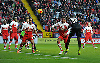 Blackpool's Nyron Nosworthy heads at goal leading to their first goal  <br /> <br /> Photographer Ashley Western/CameraSport<br /> <br /> Football - The Football League Sky Bet Championship - Charlton Athletic v Blackpool - Saturday 13th December 2014 - The Valley - London<br /> <br /> © CameraSport - 43 Linden Ave. Countesthorpe. Leicester. England. LE8 5PG - Tel: +44 (0) 116 277 4147 - admin@camerasport.com - www.camerasport.com