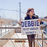 031213       Cable Hoover<br /> <br /> District 1 city councilor candidate Debbie Garcia carries her own campaign sign as she tries to sway voters outside the polling station at the Octavia Fellin Public Library Tuesday in Gallup.