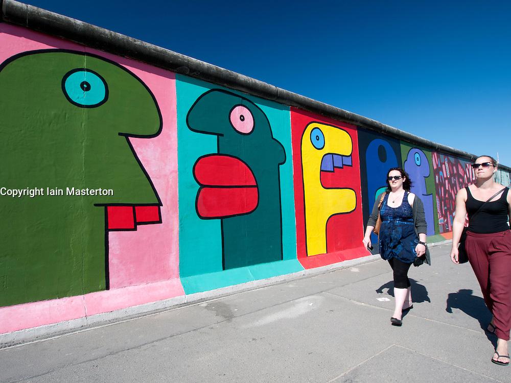 Paintings on original section of Berlin Wall at East Side Gallery in Friedrichshain in Berlin Germany