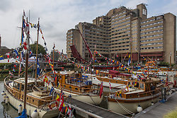 © Licensed to London News Pictures.  03/09/2021. London, UK. A number of boats are seen at St Katharine Docks Marina on the River Thames ahead of the Classic Boat Festival this weekend. With 40 vintage sail and motor yachts, the Classic Boat Festival is part of Totally Thames' 25th festival. Photo credit: Marcin Nowak/LNP