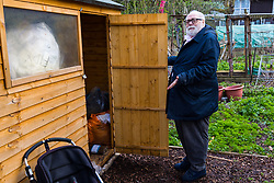 Danny Gallivan, chairman of the Regent's Park Gardening Association shows a shed containing bedding whose lock was forced, in a section of an allotment reserved as a children's play area appears to have become the residence or storage shed of homeless individuals, said by one local resident to be Romanian beggars who sleep in a lane behind the nearby tower blocks. Munster Square, Camden, March 18 2019.