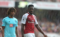 09 September 2017 London : Premier League Football : Arsenal v Bournemouth : Nathan Ake of Bournemouth and Danny Welbeck stand in the pouring rain.<br /> Photo: Mark Leech