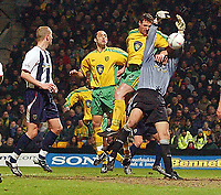 PICTURE BY DANIEL HAMBURY/SPORTSBEAT IMAGES<br /> Nationwide Football League Division One    2/3/04<br /> <br /> Norwich City V West Bromwich Albion<br /> <br /> Norwich City's Malky Mackay and West Brom's 'keeper Russell Holt  fight for the ball