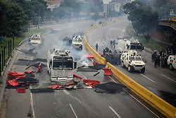 Officials of the Bolivarian National Guard demolish barricade and disperse protesters protesting against President Nicolas Maduro this May 3, 2017 on the Francisco Fajardo motorway.