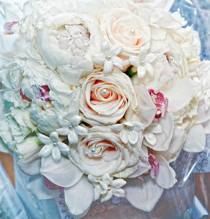White rose bouquet with pearl accents.