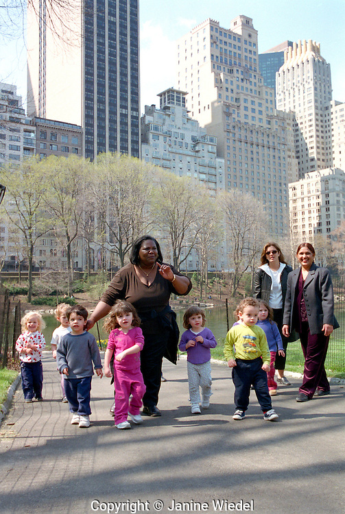Group of children being taken to Central park by childminders.