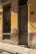 Door and sidewalk on old town street, Havana, Cuba