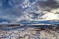 The Green River Overlook in Canyonlands National Park is an amazing site to see.  Add to that the fresh blanket of snow and an amazing sunset and you can't find a better view.
