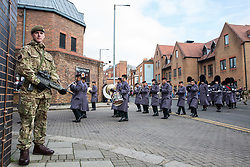 Windsor, UK. 21st February, 2019. The Band of the Brigade of Gurkhas, followed by 1st Battalion Coldstream Guards, returns to Victoria Barracks after accompanying 36 Engineer Regiment Queen's Gurkha Engineers in the Changing of the Guard ceremony at Windsor Castle. The Queen's Gurkha Engineers will provide the Windsor Guard until April 12th, for the first time since the celebrations marking 200 years of service to the Crown in 2015.