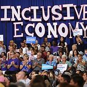 Supporters for Democratic presidential candidate Hillary Clinton clap during a campaign stop at the Frontline Outreach Center in Orlando, Fla., on Wednesday, Sept. 21, 2016. (Alex Menendez via AP)
