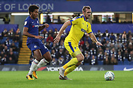 AFC Wimbledon striker James Hanson (18) battles for possession with Richard Nartey of Chelsea (48) during the EFL Trophy match between U21 Chelsea and AFC Wimbledon at Stamford Bridge, London, England on 4 December 2018.