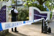 A police officer guards a crime scene nearby Westbourne Park Open Space in Bourne Terrace on Sunday, Sept 20, 2020 - after a woman has been found suffering from knife wounds and pronounced dead in West London, which police say it is believed to be self-inflicted. (VXP Photo/ Vudi Xhymshiti)