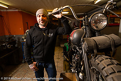 Reini Servello with one of his Panheads in his Bobber Garage custom motorcycle shop. This shop is the only custom shop in Liechtenstein! (fyi - there are just 38,547 citizens & this country covers just 62 sq mi tucked in between Switzerland and Austria.) The shop is in the the biggest city, Vaduz, at the foot of the mountain and as Reini likes to say, just below where the Boss Man lives (the prince in his castle!)   Monday, February 25, 2019. Photography ©2019 Michael Lichter.