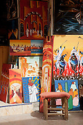 Paintings from local artists for sale at a shop in the medina of Essaouira in Morocco