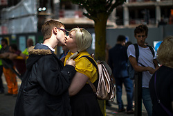 © Licensed to London News Pictures . 30/07/2017 . Manchester , UK . A couple kiss at the entrance to the venue . Cosplayers, families and guests at Comic Con at the Manchester Central Convention Centre . Photo credit : Joel Goodman/LNP