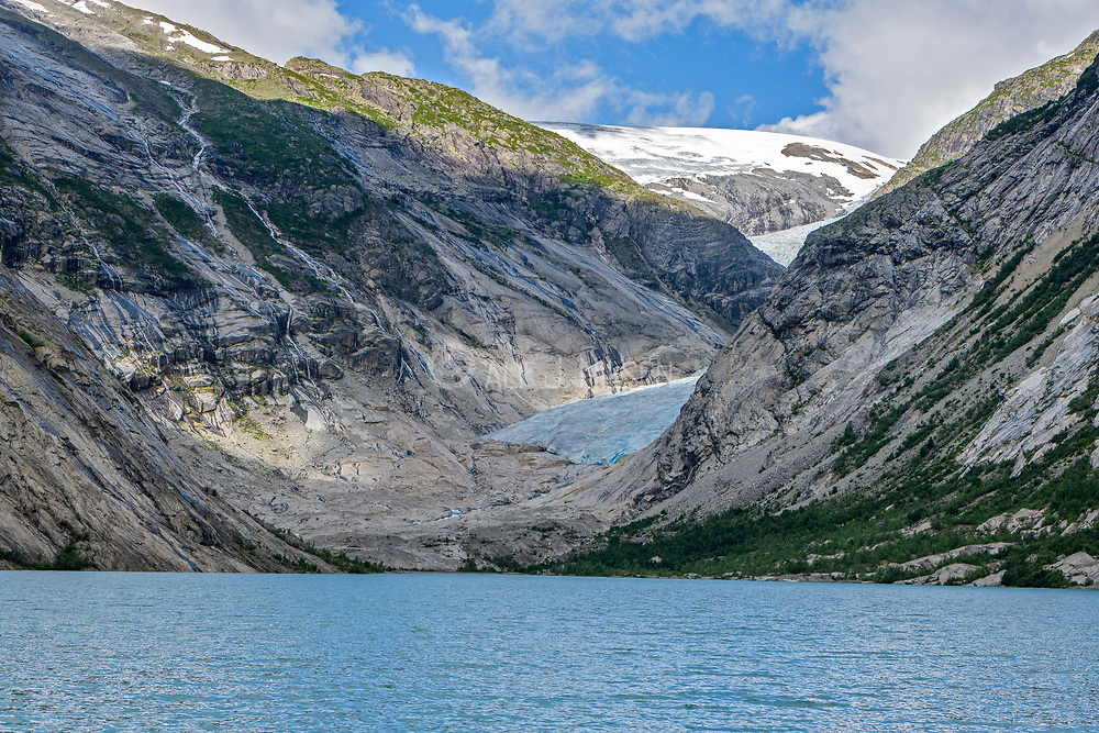 The glaciers Nigardsbreen and Jostedalsbreen in Jostedalen (Jostedalsbreen National Park), Luster, (Vestland county), Norway in July 2021.  Sadly the glacier is retracting, clearly visible in this photo.