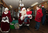 Jake Mize visits with Santa Claus while his big brother Sam waits his turn at the Lakeport Freight House Museum on Saturday afternoon.  (Karen Bobotas/for the Laconia Daily Sun)