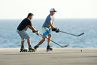 22 January 2011:  Former professional ice hockey player Darren Partch keeps the ball away from Chris Mullin while playing PBHA outdoor roller hockey on the blacktop in Newport Beach, CA.  ©ShellyCastellano.com